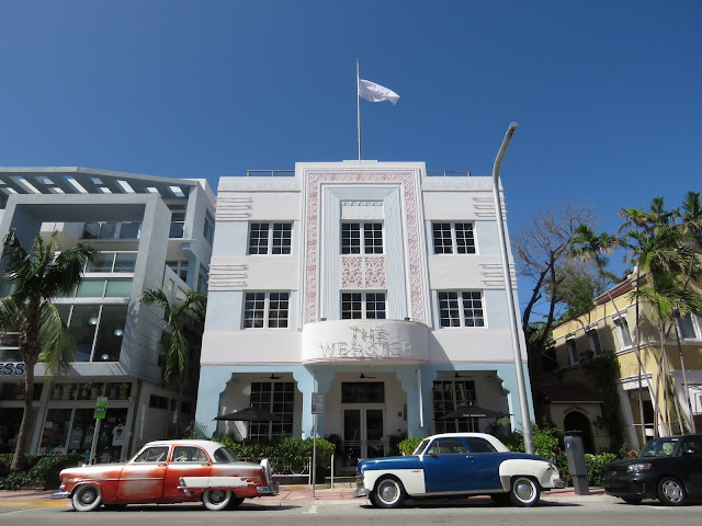 Art Deco Building in Miami South Beach with classic cars out front