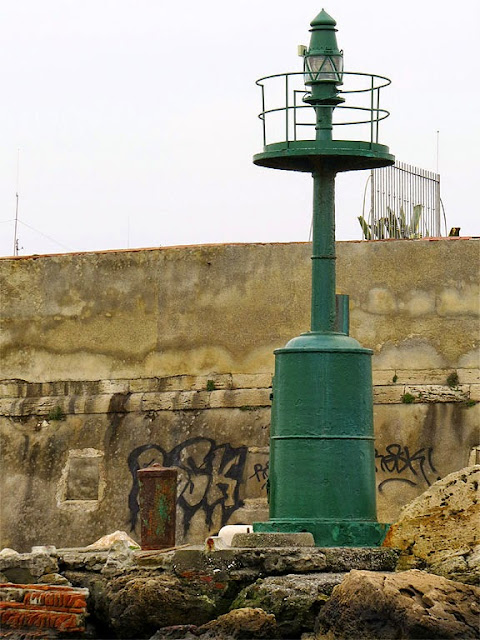 Old cannon used as bollard, port of Livorno