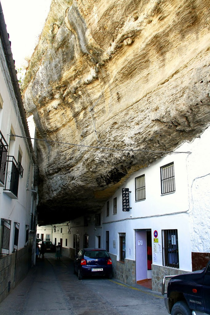 Setenil de las Bodegas is also one of the typical white villages of Andalucia - the houses are whitewashed every year in an effort to make the town as cool as possible. - The People In This Spanish Town Are Literally Living Under A Rock.