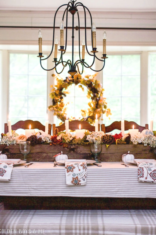Fall dining room with rustic wood box centerpiece and large wreath in window