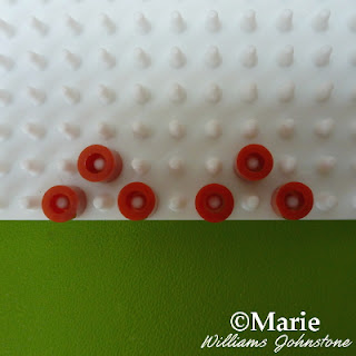 Brown beads on the peg board
