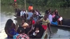 using canoe in calabar itu road
