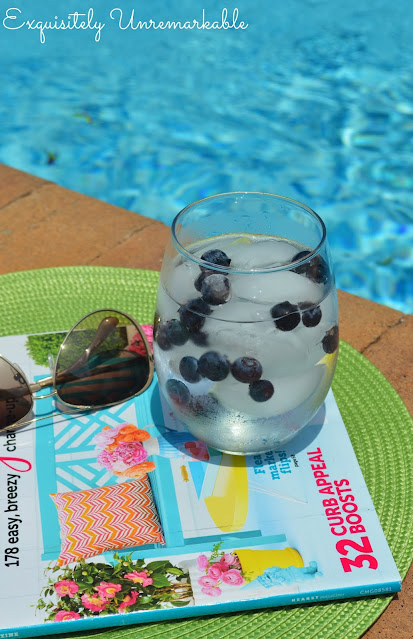 Blueberry water in glass by pool