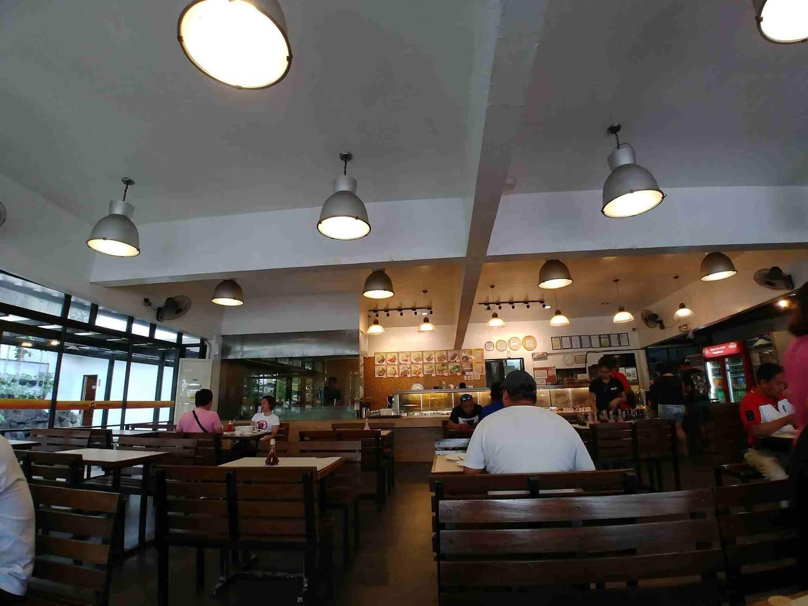 Busy interiors of a Tapsi ni Vivian branch with diners occupying tables