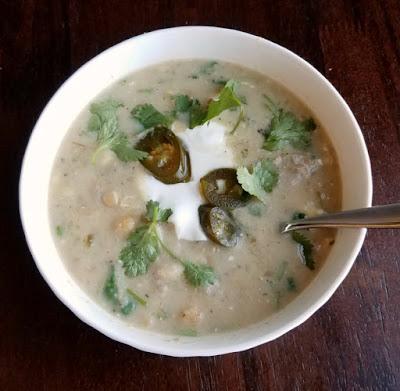 white bowl filled with pork enchilada verde soup