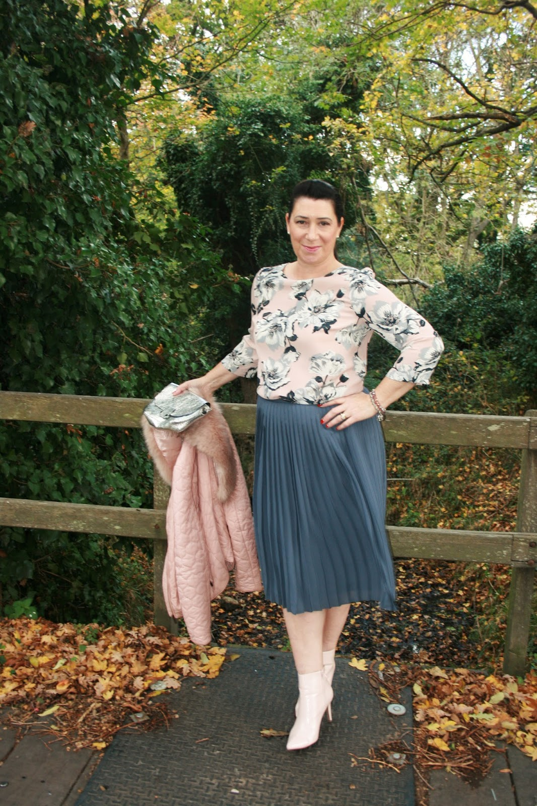 Image showing over 40 blogger Jacqui Berry from Mummabstylish in pink patent ankle boots and grey pleated skirt