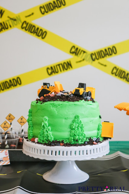 Easy Construction Themed Birthday Cake with fake dirt, rocks, and trucks