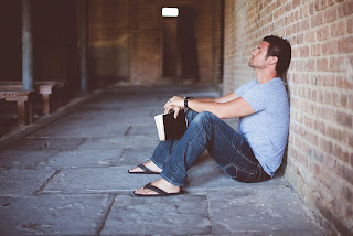 The surrendered life - hipster with bible thinking