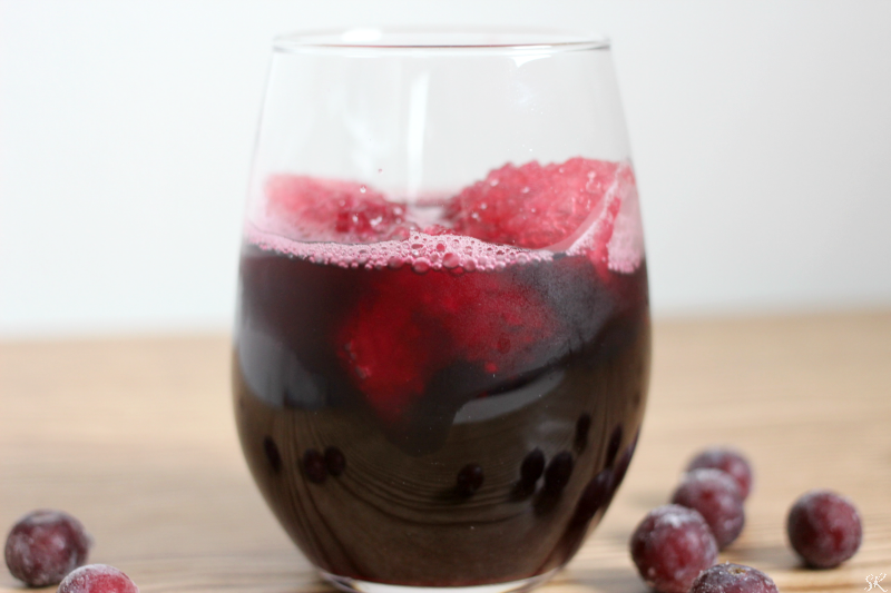 grape juice cocktail with ice and grapes