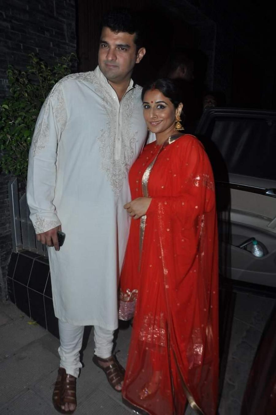 Vidya Balan Husband Photos At Diwali Party In Red Dress