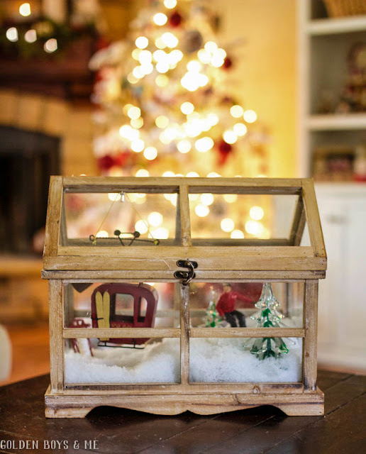 Terrarium used as Christmas decor with ski scene