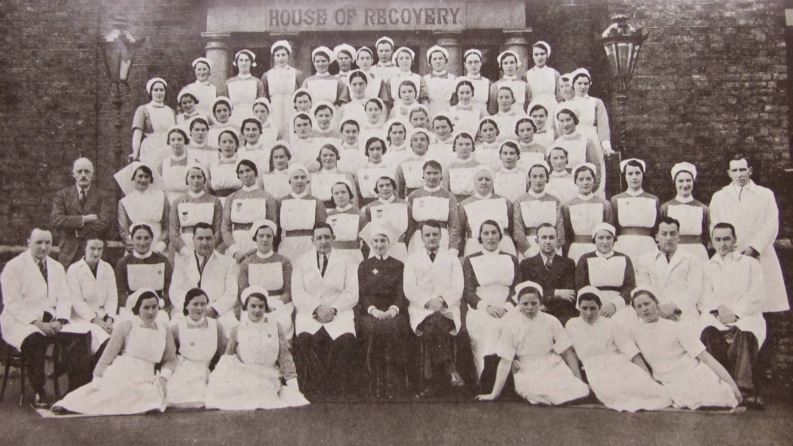 Staff of Cork Street Fever Hospital, Dublin, Ireland 1938. Dr. C. J. McSweeney, Medical Superintendent, is  pictured sixth from the right in the second row