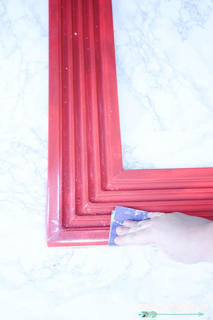 DIY Christmas Card Holder | Put together this oversized holiday card display with moulding and L brackets (and mesh!). Check out the entire tutorial.
