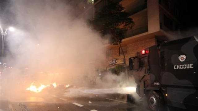 Brazilian police fire tear gas at protesters supporting suspended president Dilma Rousseff in Sao Paolo
