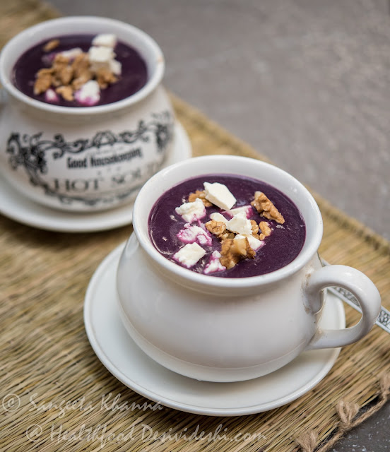black carrot soup with walnuts and feta