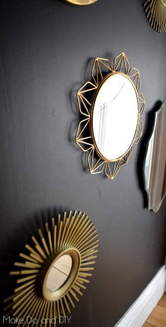 black gold gallery mirror feature wall