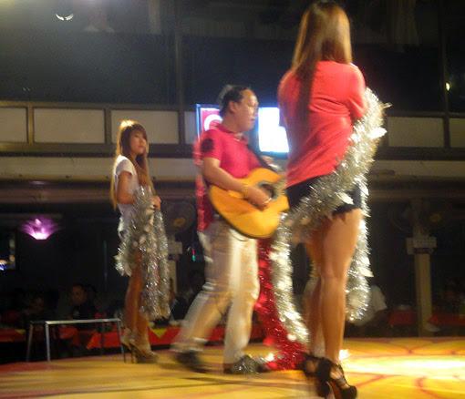 The boss of Power Light Yangon play the guitar