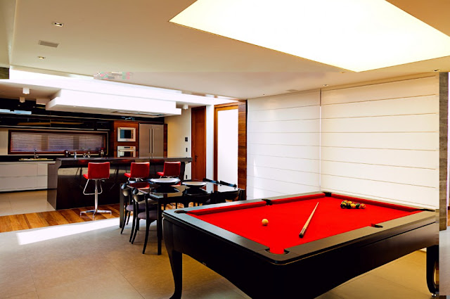 Picture of red pool table in the living room