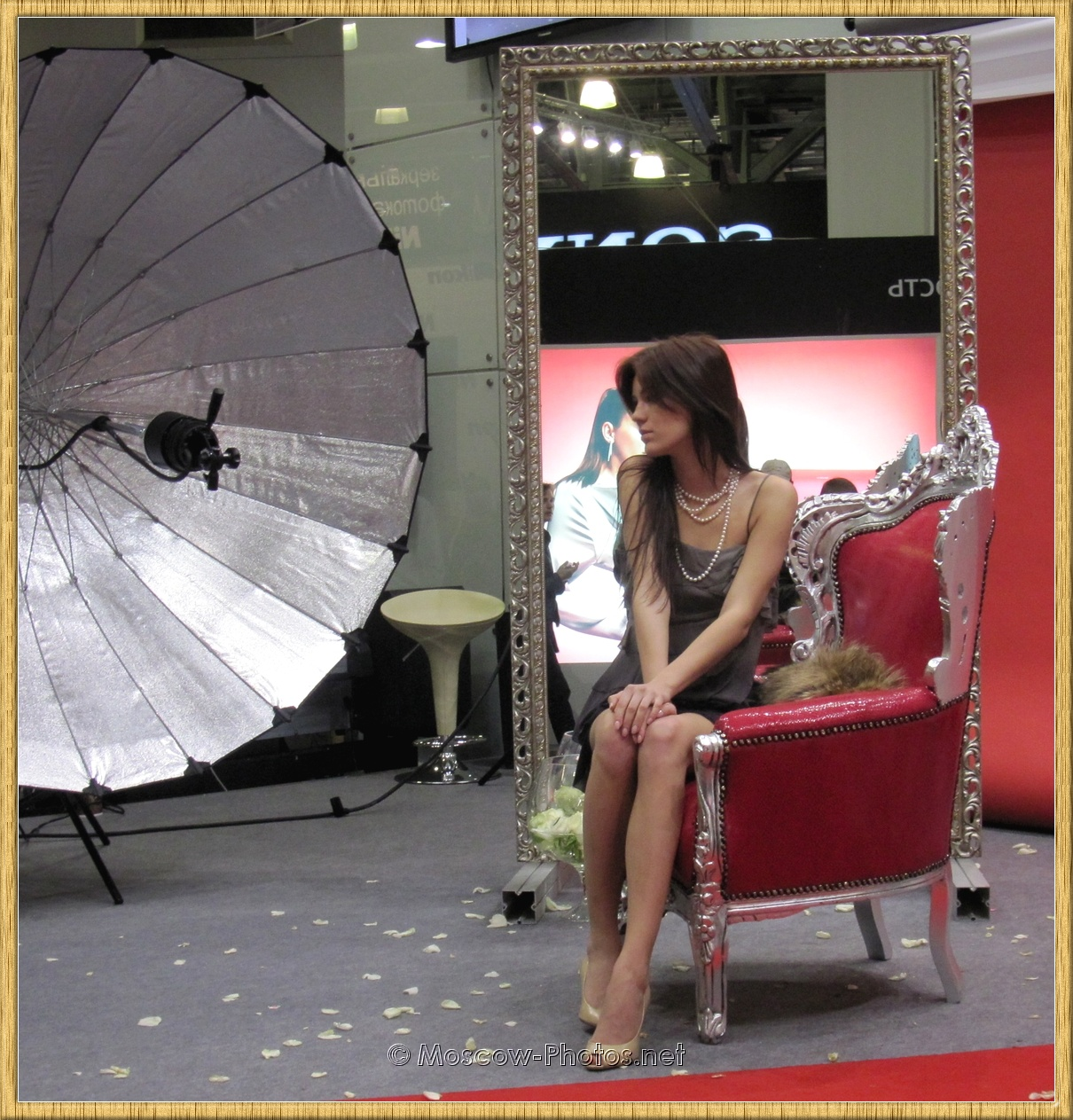 Fashion model posing in a chair