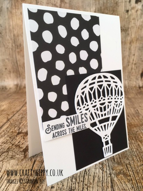 A monochrome hot air balloon card showing a white die-cut balloon made with the Up & Away Thinlits Dies by Stampin' Up!
