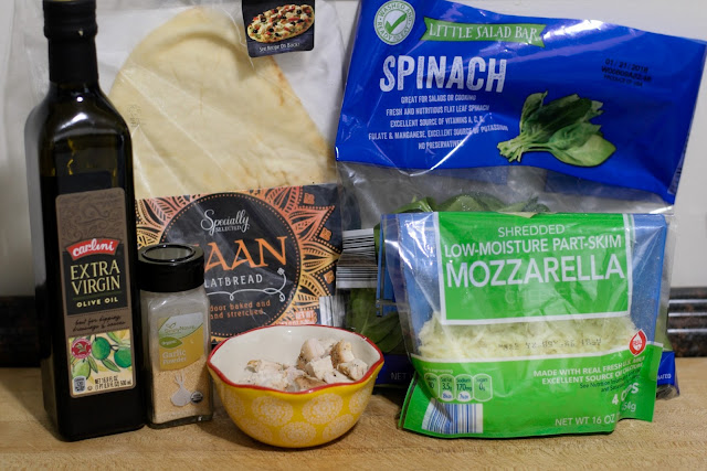 The ingredients needed to make the Chicken and Spinach Naan Bread Pizza Recipe.