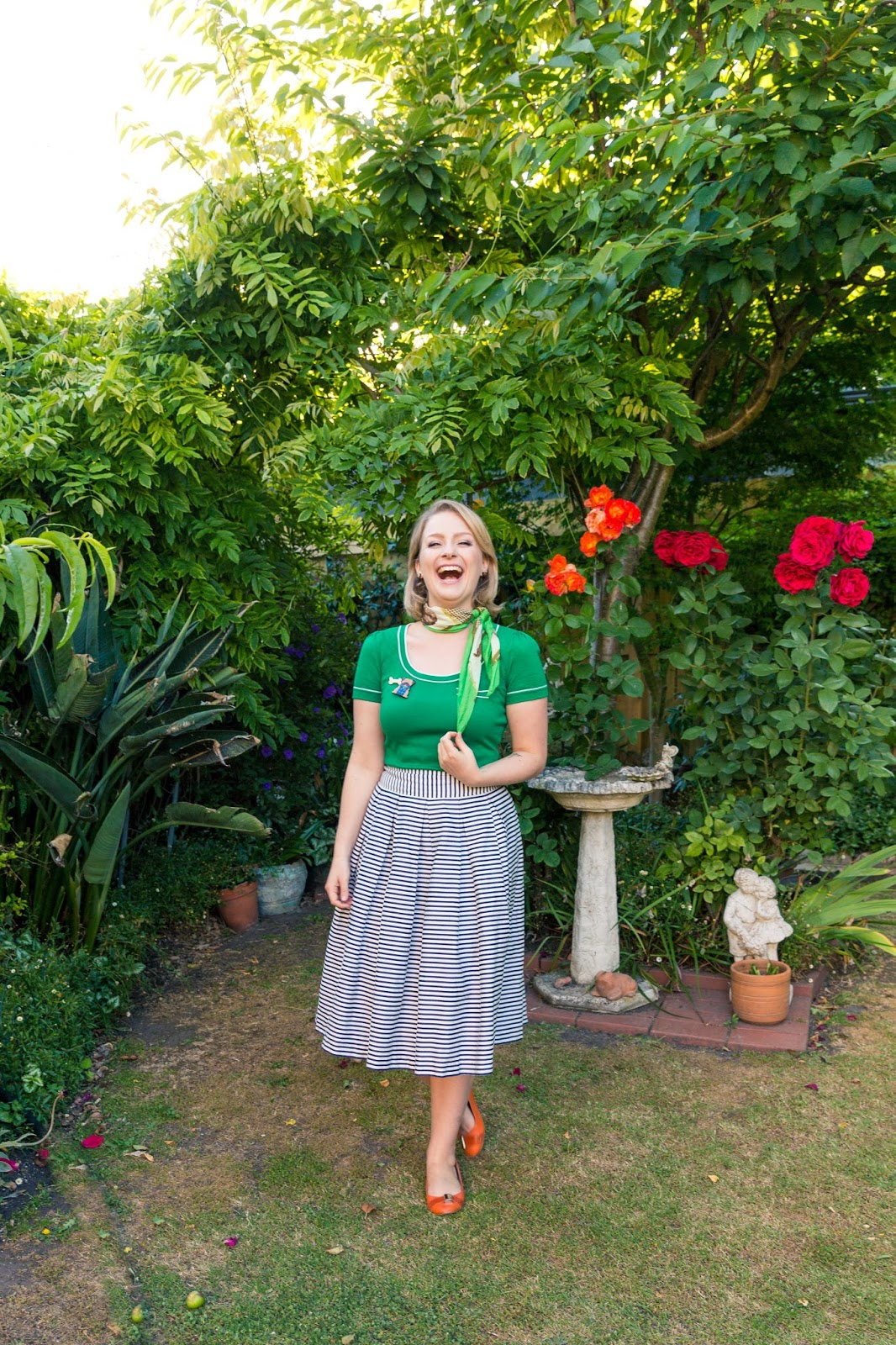 @findingfemme wears green Review top with navy striped skirt and orange Mimco flats.