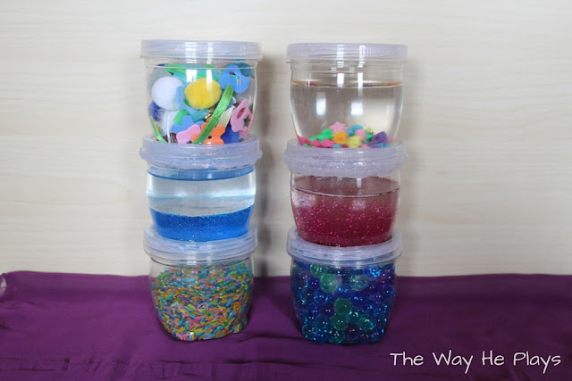 6 discovery jars with a variety of objects inside
