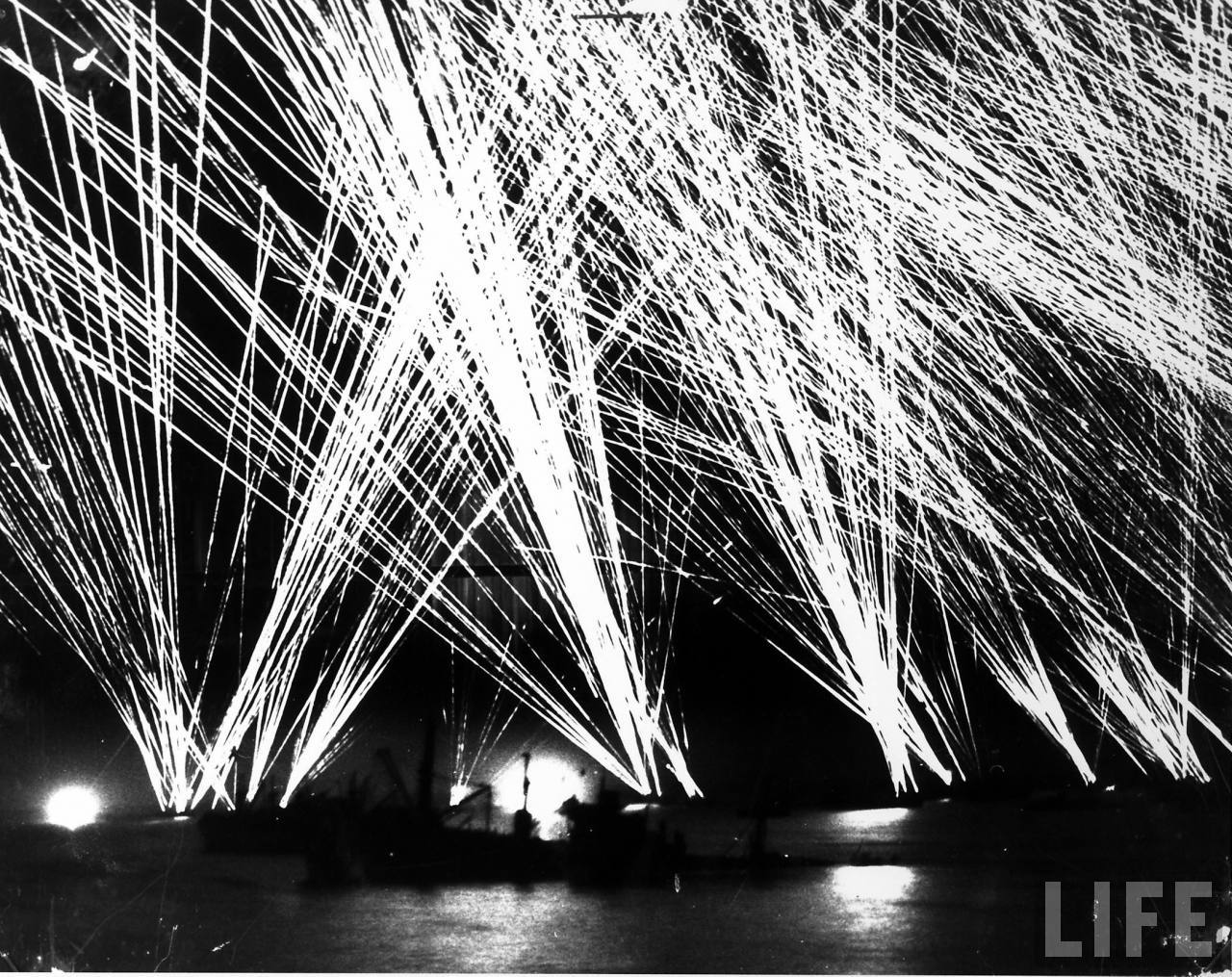 D-Day anti-aircraft fire lights the sky on the first night