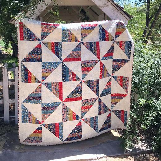 Pinwheel Party Jelly Roll Quilt Free Pattern designed by Primrose Cottage Quilts for Bluprint