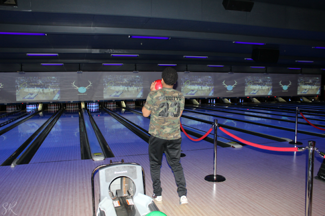 man bowling at Bowlero bowling alley