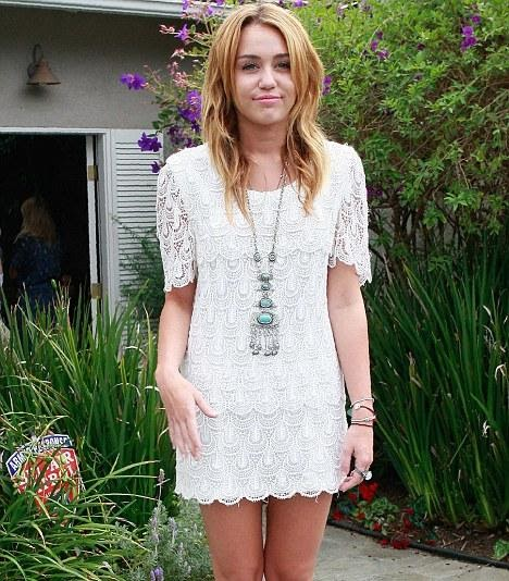 Miley Cyrus Attempts A Demure Look In A Pretty White Lace