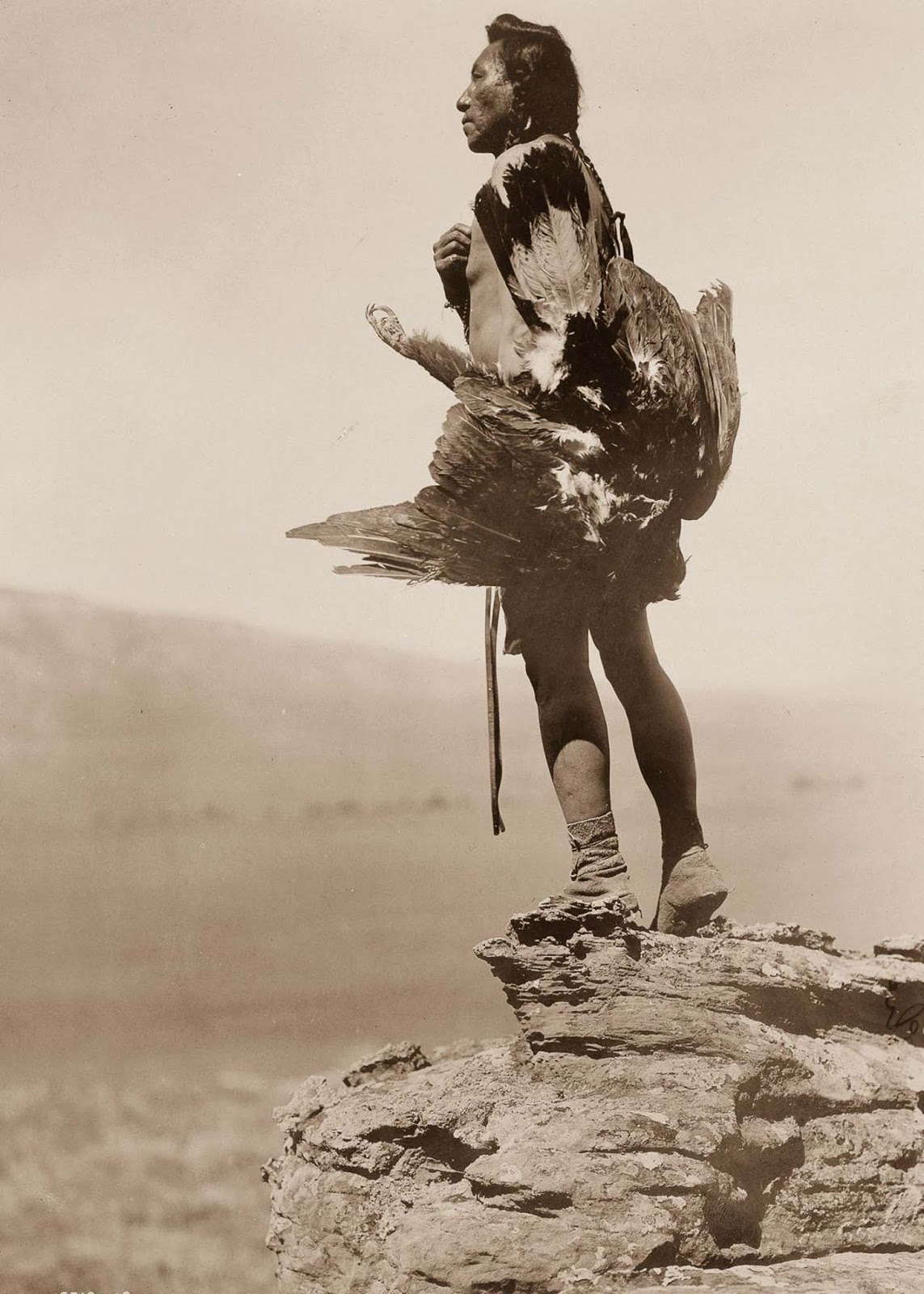 A Hidatsa man with a captured eagle. 1908.