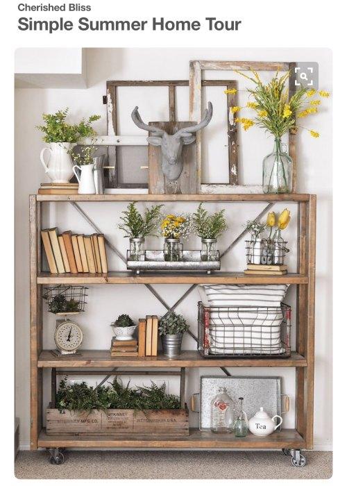 wooden cart, vintage scale, flowers, bottles, books