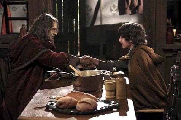Once Upon a Time - Rumpelstiltskin at dinner table shakes hands with his son