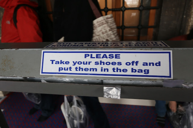 Remove and keep your shoes in a plastic bag before entering Blue Mosque at Sultanahmet Square in Istanbul, Turkey