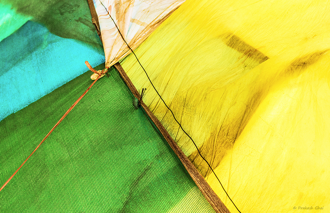 A Minimalist Photograph of Colorful fabrics used by a Tea seller to protect and cover his Tea Stall/ kiosk from heat.