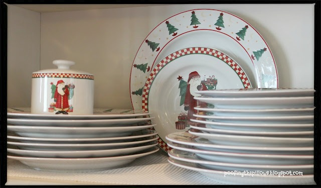 Santa Clause Christmas dishes on display in kitchen.