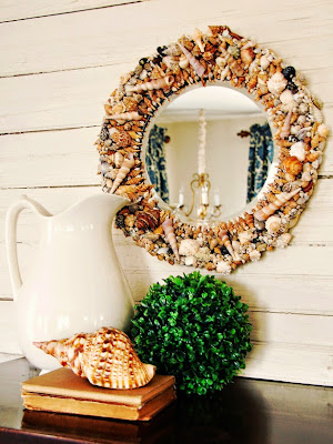 espejo con conchas de mar