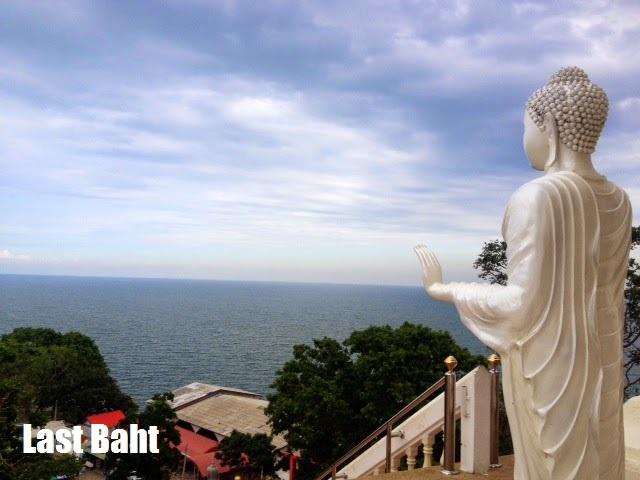 white marble Buddha statue looks over Hua Hin and the sea