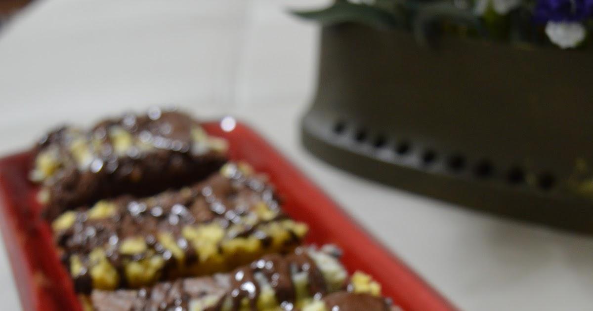 Mattoncini cioccolato e cocco con crema aromatizzata con Grappa al Miele