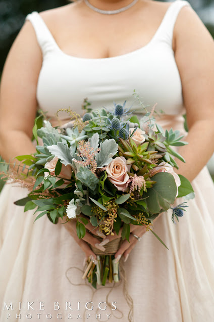 Bride with succulent bridal bouquet