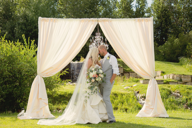 Bride and Groom / Ceremony Arch / Flowers by Mac's Floral / Photography: Tracy Moore Photography