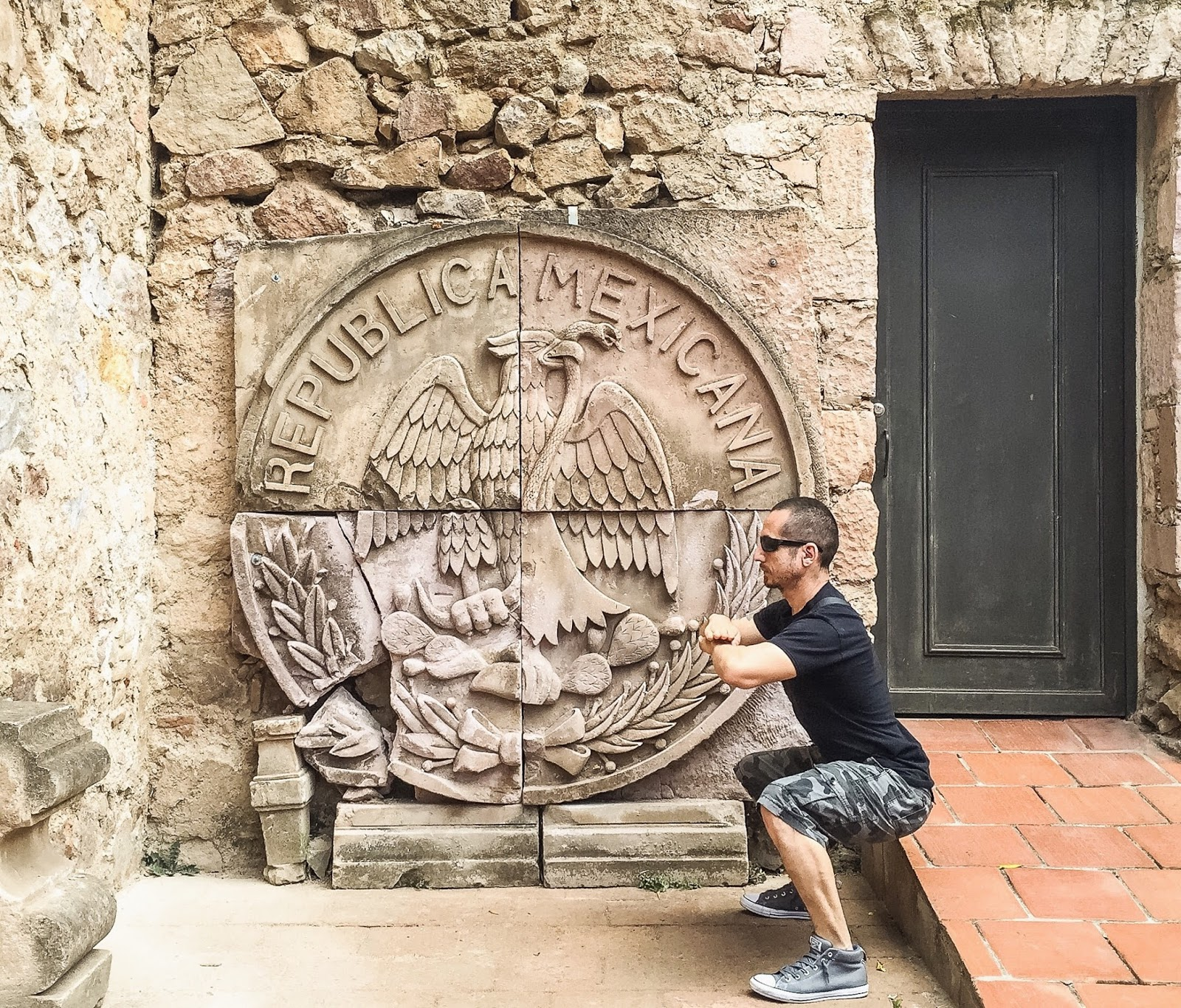 Pasadena fitness trainer squatting