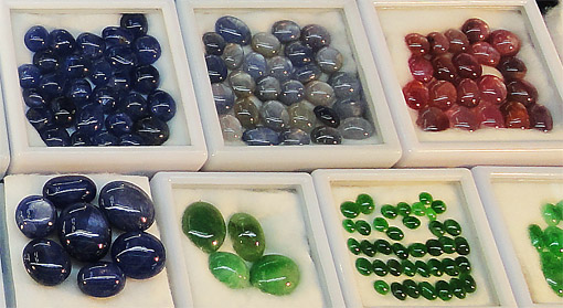 Gemstones as blue red and green cabochons