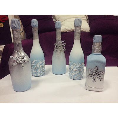 K'Mich Weddings - wedding planning - frosted bottles as centerpieces