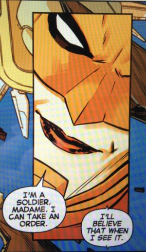 A panel depicting a close-up of Carol's masked face. She says, 'I'm a soldier, Madame. I can take an order.' An unconnected voice bubble reads, 'I'll believe that when I see it.'