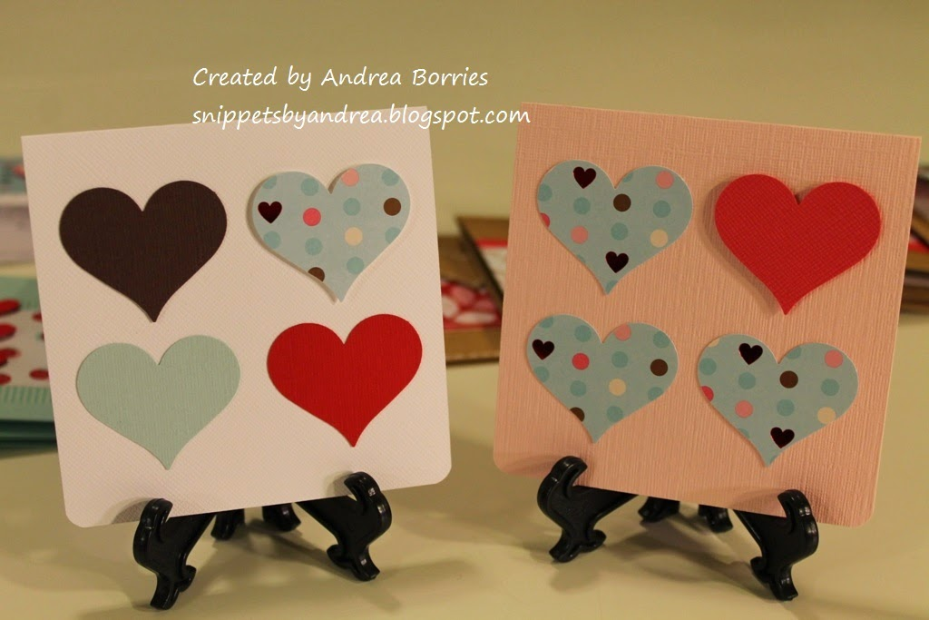Two simple valentines each made with four punched hearts arranged in a square on a solid card stock base.
