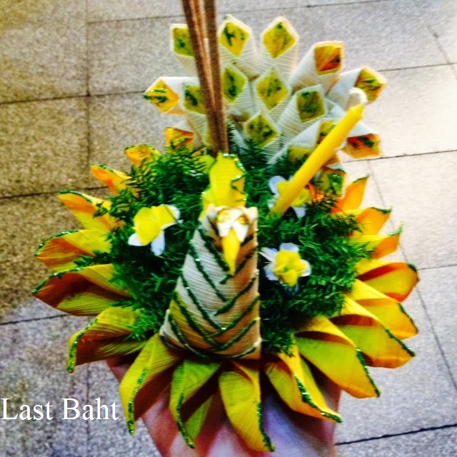 a green and yellow krathong float for a Thai river festival