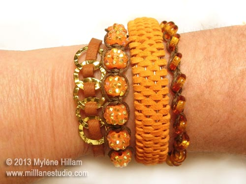 Bangle stack of 4 bangles and bracelets including gold rings woven with tan lace, shamballa beads and twine, orange peel domed woven leather bangle and transparent glass donut beads on woven beading cord.