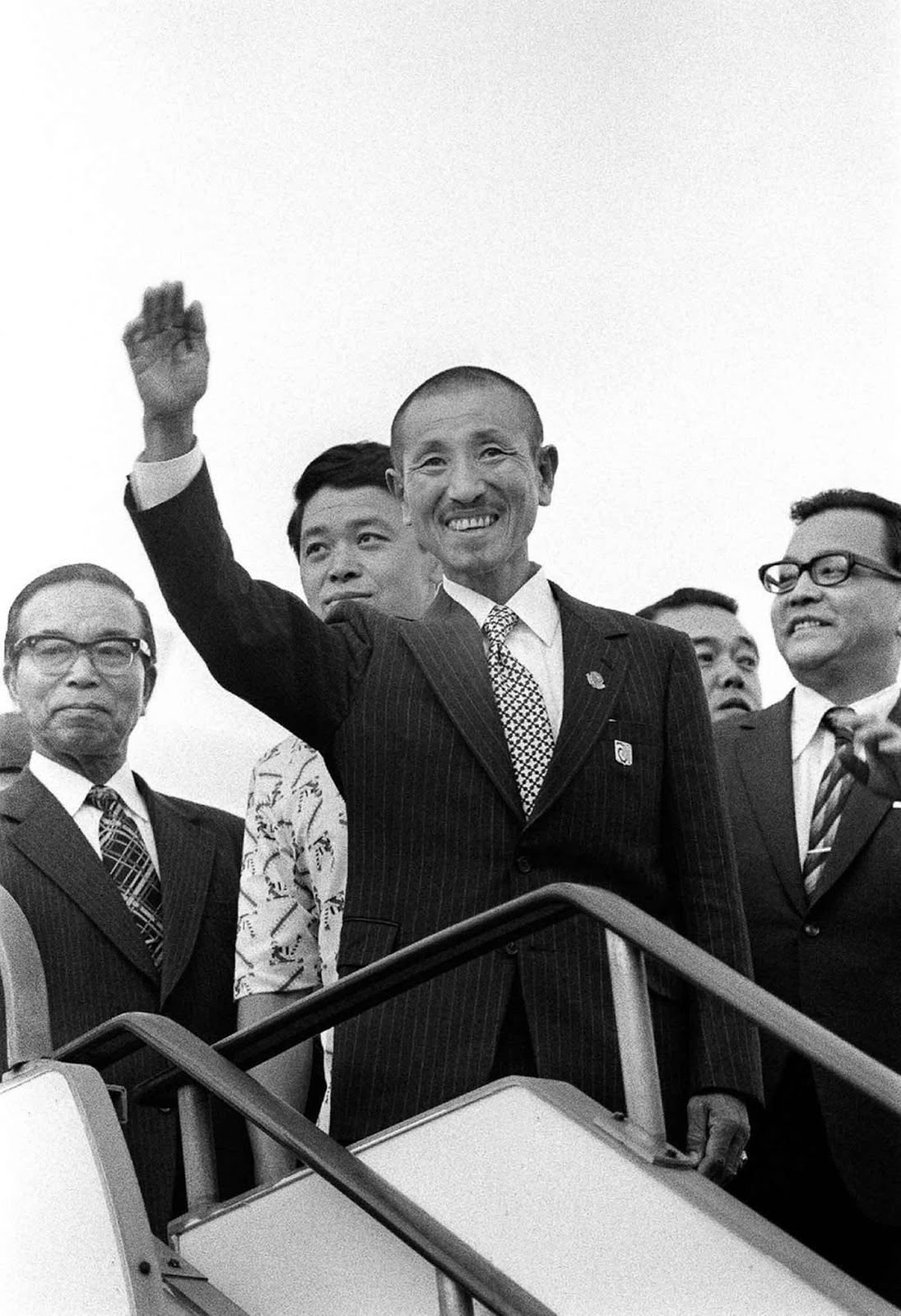 Onoda waves upon arriving back in Tokyo. March 12, 1974.